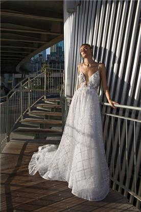 שמלת כיווצים אוגנזה