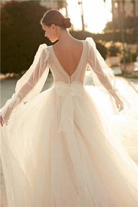שמלת כלה עם כיווצים