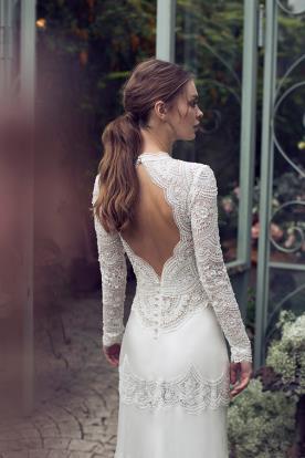 שמלת כלה עם שרוולים ארוכים בקישוט חרוזים