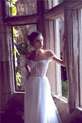 שמלות כלה בגזרה אסימטרית
