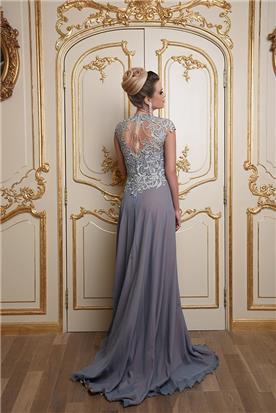 שמלת ערב כחולה עם אפליקציה מיוחדת בגב