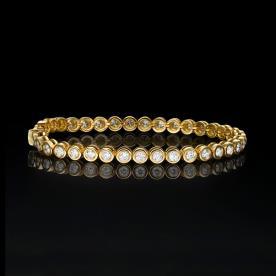 צמיד כדורים מזהב צהוב עם יהלומים