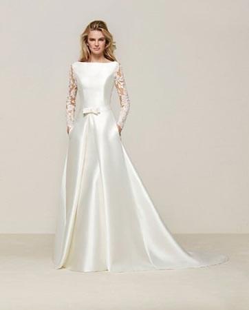 10 שמלות כלה עם שרוול ארוך: מי אמר 'צנוע'?