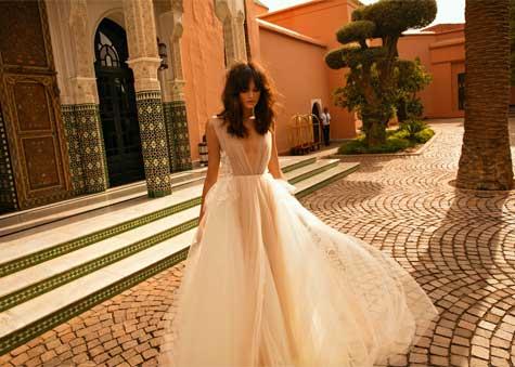 שמלת כלה עם שקופויות ותנועתיות בבד