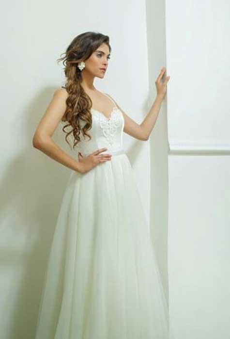 שמלת כלה: מיטל גמליאל.  צילום: רועי ביתן
