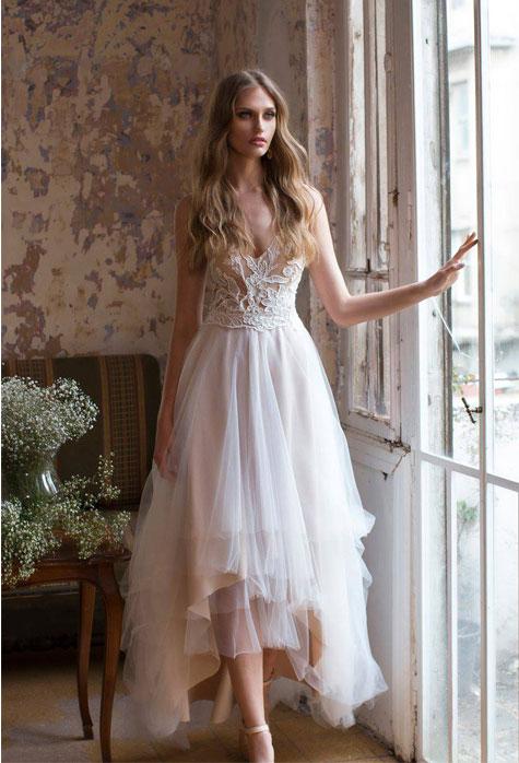 שמלת כלה עם משחקי אורכים